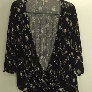 Black floral wrap shirt with tie at the side.